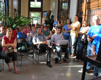 The overflow crowd in the lobby of the county administration building arrived too late for a seat in the boardroom.