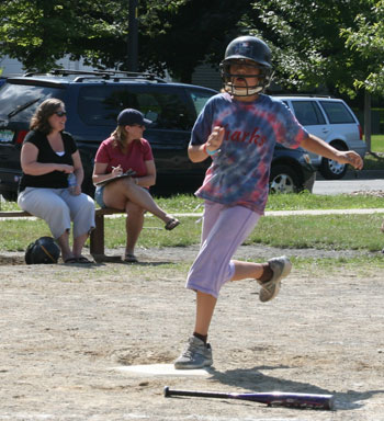 Julia Friedman, a member of the Sharks team coached by her sister Rebecca, scores a run.