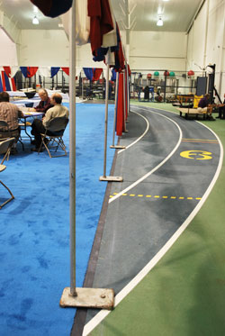 This small section of track is one of the few spots not covered by bright blue carpet throughout the UM Indoor Track Building.