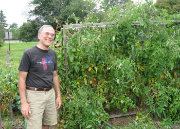 Royer Held at his Project Grow garden, where he grows heirloom tomatoes.