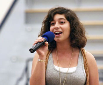 Huron High School senior Noa Gutterman sings The Star-Spangled Banner during an audition to becoming a national anthem singer at U-Ms sporting events.