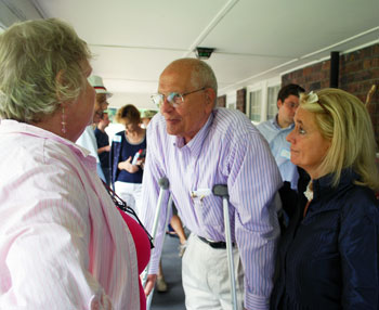 Congressman John Dingell and his wife, Debbie Dingell, right, talk to Lois Mayfield on the porch of the Elks Pratt Lodge.