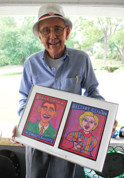 Doug Kelley with Steve Shepard portraits of Obama and Hillary Clinton.