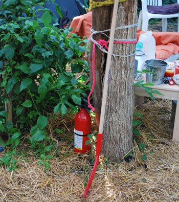 fire extinguisher next to straw