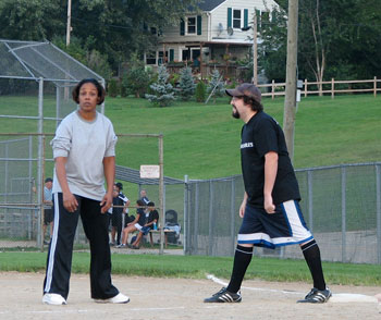 Karla Tensley from Jiminy Kick It plays first base as runner Ben Pierce of The Untouchables gets ready to make a play for second.