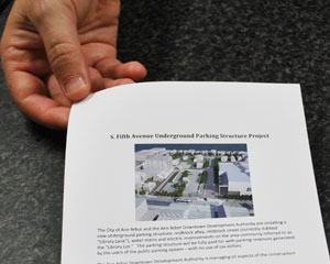 Librarians are passing out these informational flyers to patrons, giving details about the closure of the city-owned lot next to the downtown branch. The lot will be closed on Sept. 30 at 4 p.m., as construction begins on the underground parking structure.
