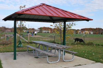 A fence separates this pavilion from the Olson Dog Park.
