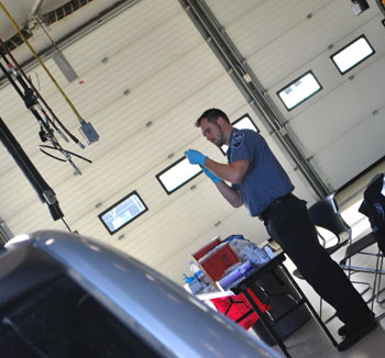 medic prepping a flu vaccination in a garage bay