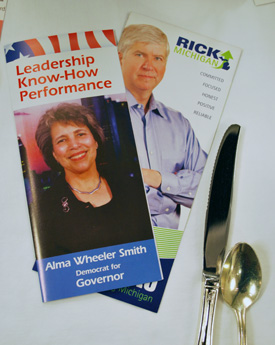 Pamphlets for gubernatorial candidates Alma Wheeler Smith and Rick Snyder, on the table a Wednesday's Morning Edition meeting hosted by the Ann Arbor Area Chamber of Commerce. Smith, a Democrat, and Snyder, a Republican, were both speakers at the event.