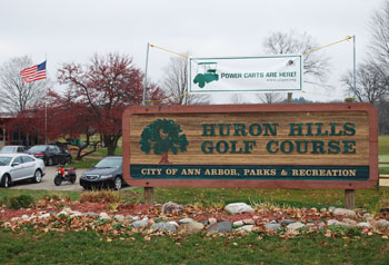 The sign for the city's Huron Hills Golf Course at the corner of Huron River Parkway and Huron River Drive. (Photo by the writer.)