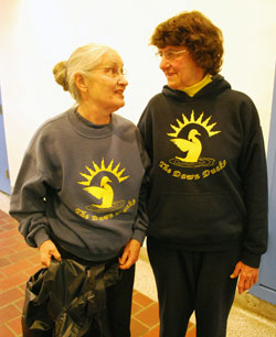 Nancy Darnell, left, and Nell Stern wore their Dawn Ducks sweatshirts. Stern, a Mack Pool Task Force member, came up with the name for the group several years ago. Zelma Weisfeld designed the logo. (Photo by the writer.)
