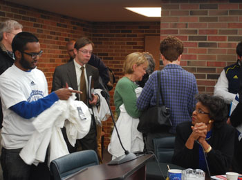 Michigan Student Assembly leaders distribute T-shirts to UM regents and administrators