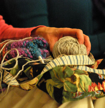 a ball of yarn on somebody's lap