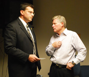 County commissoner Mark Ouimet, right, talks with xx