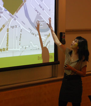 Emily Tsiang, an MBA student at the UM Ross School of Business, describes Broadway Mills, a project that her team developed for Peter Allen's course on urban design. (Photo by the writer.)
