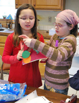Anastasia Shchurin and Michelle Zorine work on a four-season diorama at the Leslie Science and Nature Center's holiday break camp.