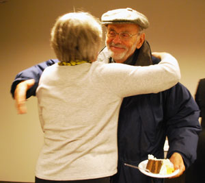 Jim Kern, outgoing public art commissioner, gets a hug from Margaret Parker, the commission's chair, after Tuesday night's meeting. The Ann Arbor Public Art Commission is recruiting replacements for Kern and Jan Onder, who is also leaving AAPAC at the end of the month. (Photo by the writer.)