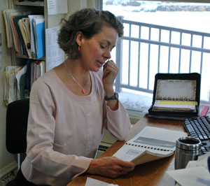 Kirsten Levinsohn at her desk in the main office of the Leslie Science and Nature Center.