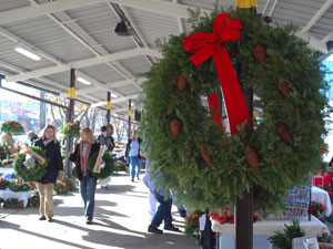 Wednesday's Ann Arbor Farmers Market was full of holiday greenery for sale. The market will be open on Friday evening, Dec. 4, from 6-10 p.m. for KindelFest, with live music, food, drink and local vendors. (Photo by the writer.)