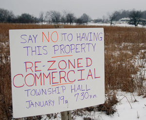 A sign opposing property rezoning in Superior Township