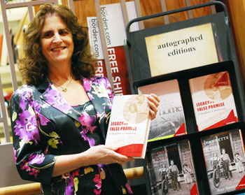 Author Margaret Fuchs Singer, next to a display that includes her memoir at the downtown Borders store on East Liberty. As of Thursday, the store had sold 45 copies of the book. (Photo by The Chronicle)