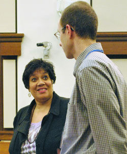 Trenda Rusher talks with Aaron Kraft at an April 15, 2009 meeting of the Washtenaw County Board of Commissioners.