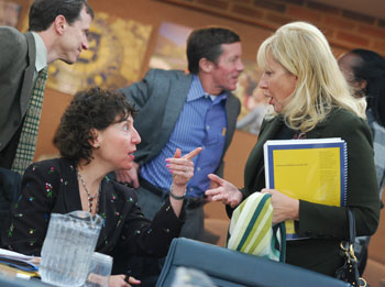 University of Michigan regent Denise Ilitch, right, talks with Ora Hirsch Pescovitz, UM's executive vice president for medical affairs.