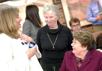 UM provost Teresa Sullivan, right, talks with regents Andrea Fischer Newman, left, and Libby Maynard, center, after the Jan. 21 board of regents meeting. Sullivan has been named president of the University of Virginia, and will be stepping down from her UM post later this year.