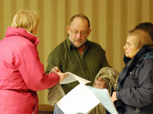 Walt Spiller, center, talks with Shirley Zempel, right, and