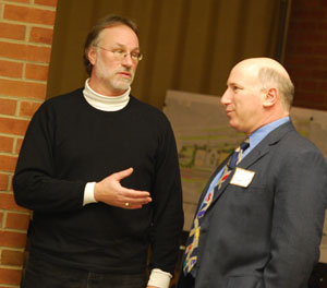 At left: Architect John Mouat, a member of the Fuller Road Station design team, talks with Eli Cooper, the city's transportation manager, before the start of the Feb. 10 citizen participation forum. Moaut is a partner in the Ann Arbor firm of Mitchell and Mouat. (Photos by the writer.)
