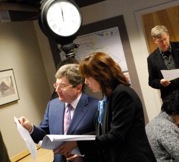DDA board member Gary Boren talks with Susan Pollay, DDA executive director, before the start of the Feb. 3 meeting.