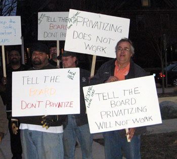 Demonstrators outside the AAPS board meeting