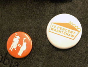 Two buttons supporting locally grown food