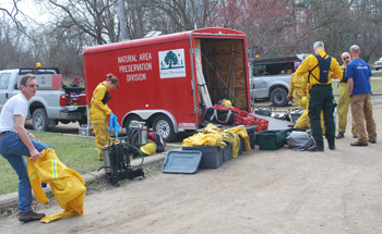 Contolled burn volunteers getting into their gear