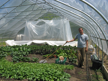 Tomm Becker in Sunseed Farm's hoop house