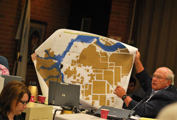 Tony Derezinski with a map of Ann Arbor