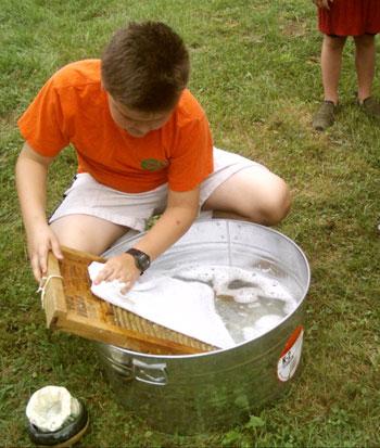 Kids scrubbin on the scrubboard
