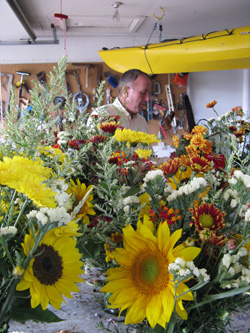 Kirk Jones arranging flowers in his garage