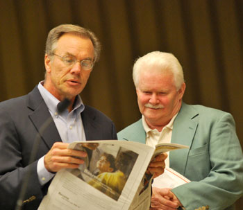 Jim Kosteva and Mike Anglin read the Record