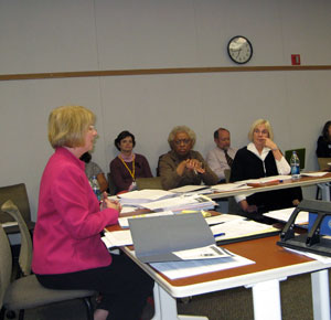 Lee Ann Dickinson-Kelley and other AAPS administrators presenting the Achievement Gap Elimination Plan to the board.
