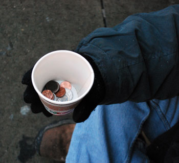 Panhandler's cup of coins