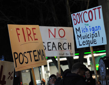 Protesters outside the Jan. 3, 2011 Ann Arbor city council meeting