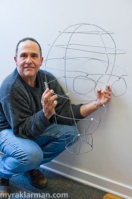 Rick Cronn holds his wireframe of a giant head.