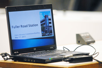 Laptop with slide presentation on Fuller Road Station