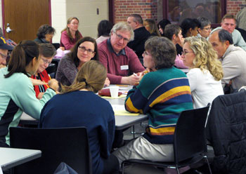 AAPS trustee Andy Thomas (maroon shirt) took notes at one of the smaller group discussions.