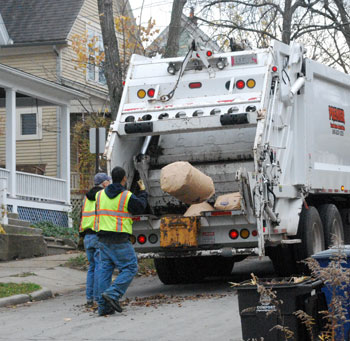 A leaf truck rented from Premier Truck Sales & Rental in action back in 2011 on the Old West Side in Ann Arbor.