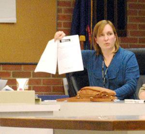City planner Jill Thacher shows licensing board members what some of the supporting application materials looked like.