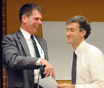 City administrator Steve Powers and Christopher Taylor (Ward 3) shared a light moment before the meeting starts.