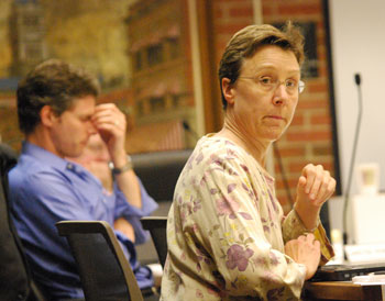 Margie Teall (Ward 4) looks The Chronicle right in the eye, as Carsten Hohnke in the background reflected the energy levels of many attendees by the end of the meeting, which concluded around 1:30 a.m.