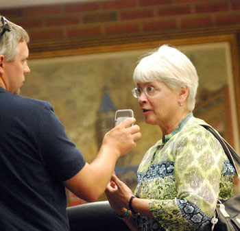 Andrew Cluley, of WEMU, interviews Marcia Higgins after the meeting.